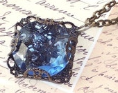 SALE - Sapphire Glass Beveled Nugget Wrapped in Gunmetal Filigree Pendant and Necklace