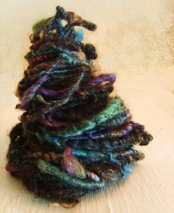 Hand spun yarn Coil Bulky corespun hebridean amble Art Yarn 32yards