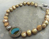 sunlit path...golden freshwater pearls with a rustic turquoise czech glass coin