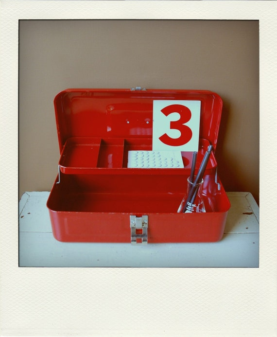 bright red metal fishing tackle tool box organizer