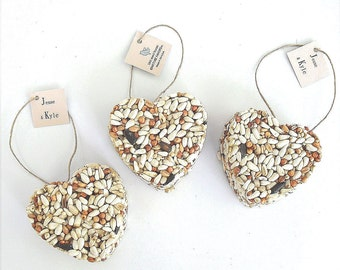 50 bird seed heart wedding favors, free personalized tags and table display sign by nature favors