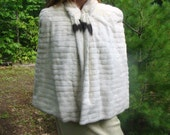 White ermine cape from 1930 with Bakelite clasp and tails. Fur of Royalty.