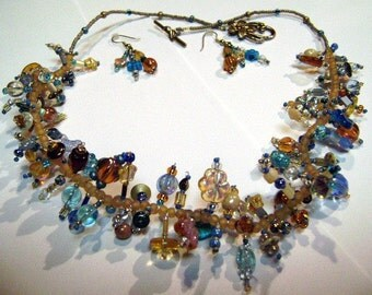 Ambers, goldens, aquas and the blues Profusions style necklace and earrings