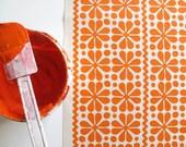 Parade print in Orange on Organic Cotton
