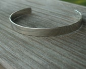 Mens cuff bracelet with secret inscription and brushed finish