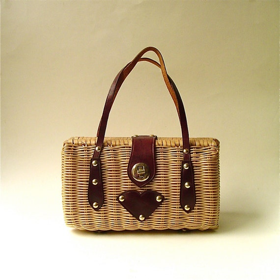 R e s e r v e d..............................Mid Century vintage Woven Rattan Purse with Leather Trim
