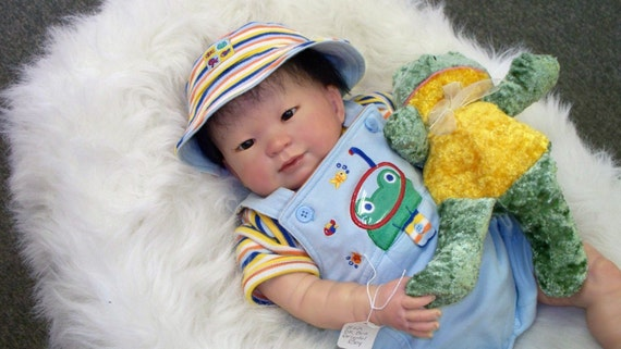 Asian Boy in Frog Outfit