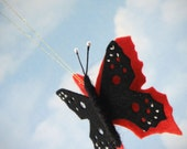 Orange and black butterfly - made using traditional Waldorf methods and all natural wool felt