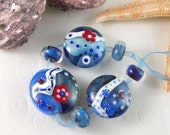 SALE 30% - Sea shore - Set of 7 red and blue lentil lampwork beads - Artbeadies