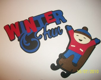 Winter fun title and boy sledding die cut