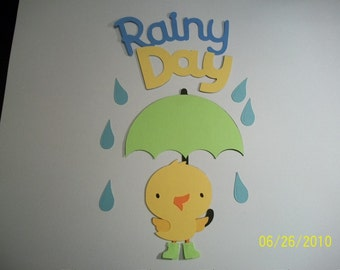 Chick with umbrella and rainy day title diecuts