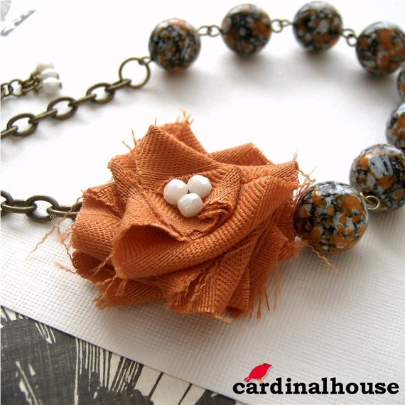 Rosa. Necklace with orange and white fabric flower and vintage speckled beads.