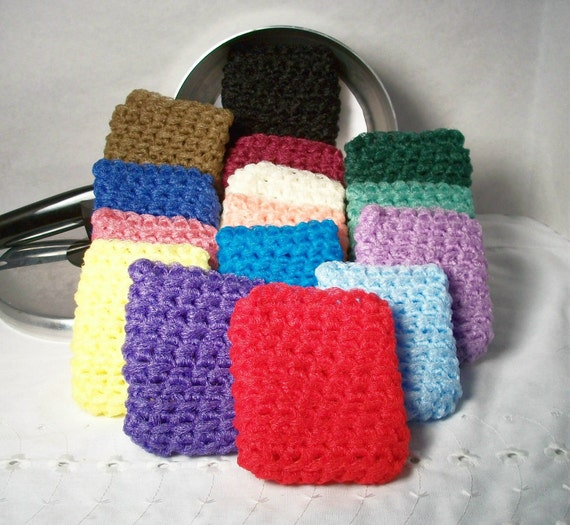 Pot Scrubbers that are square for getting into corners of bakeware. There's 15 colors for you to choose from for your kitchen and home.