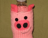 Penelope Pig. Hand knit waterbottle cozy