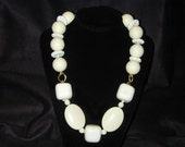 ON SALE!  Chunky ivory lucite beads on brass