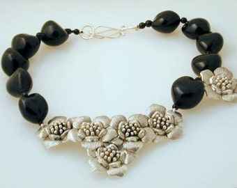 Huge silvered focal flowers on Black Kukui beads