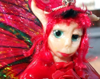 Fire Rose Fairy Rose Art doll Garden fae sitting on a mushroom miniature