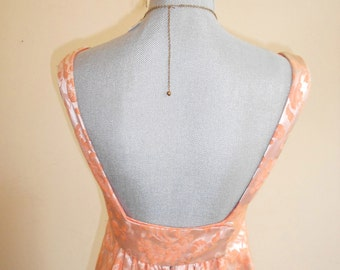 """1960's, 32"""" bust, coral satin brocade, """"empire"""" style gown with low back."""