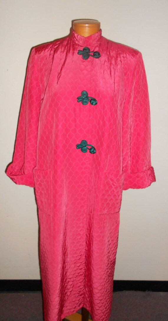 1950's large coral colored, quilted rayon house robe