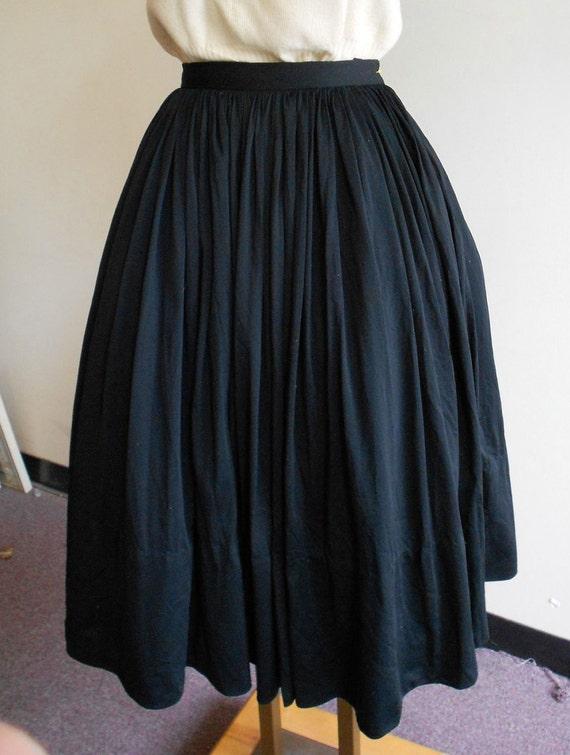 "1950's, 26"" waist, black silk dirndl skirt"