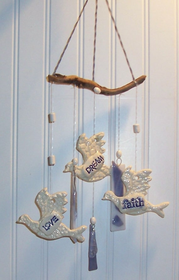 white clay doves and blue glass wind chimes