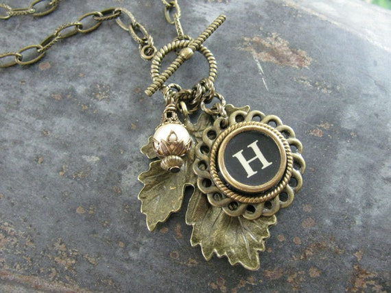 Autumn Brass Maple Leaf with Black Typewriter Key and Cream Pearl Charm Necklace on Toggle Clasp