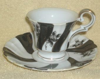 Beautiful Vintage Mini Cup and Saucer Set  (Item 33)