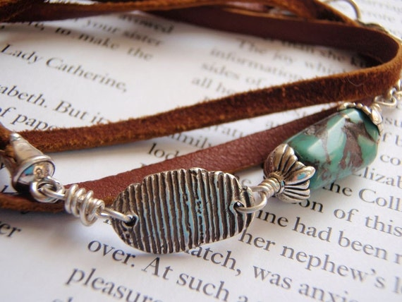 deerskin leather and turquoise wrap bracelet with artisan happy charm . sterling silver clasp and findings