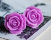 """5/8"""" (16mm) Bright Purple Flower Plugs for stretched ears."""
