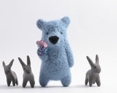 A soft blue bear with crystals in paw, brooch