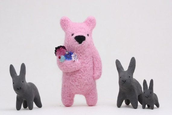 A pink bear with crystals in paw, brooch