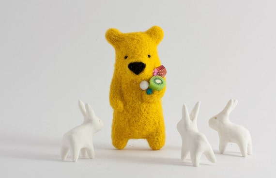 A yellow bear with crystals an kiwi in paw brooch