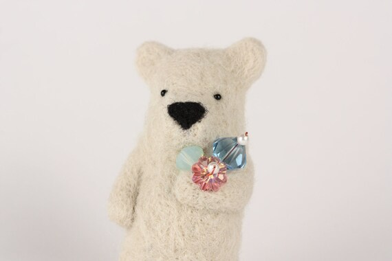 Off white bear holding crystals in paw brooch
