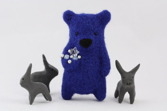 A cobalt blue bear with Swarovsky crystals in paw brooch