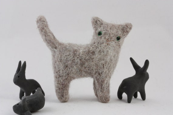 A cat with long whiskers brooch