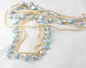 Blue Pearls Floating in Gold Necklace