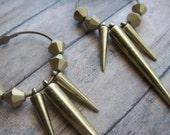 brass daggers hoop earrings