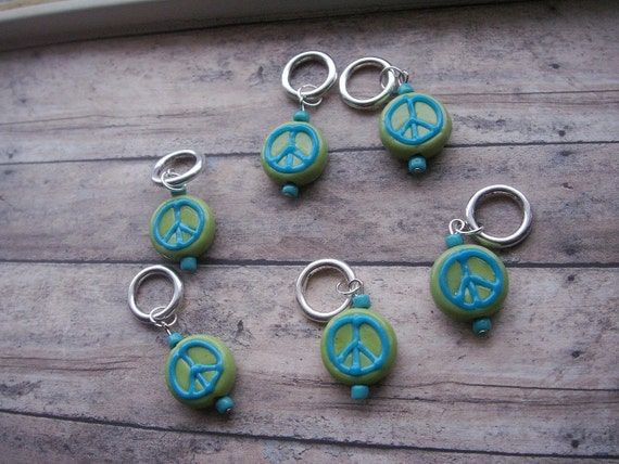 lime and turquoise peace sign lampwork stitch markers