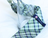 Green and navy blue plaid necktie waiting to be altered to little man size