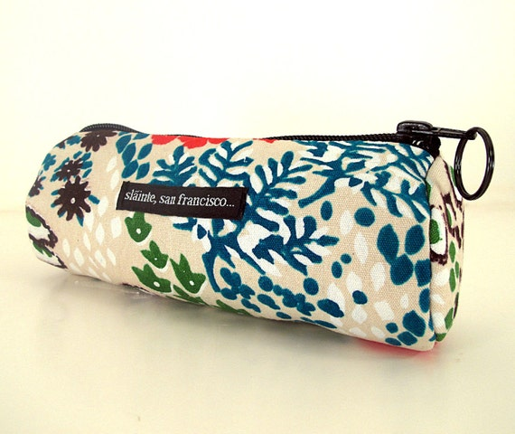 """Cosmetic Case, Pencil Case, Clutch or Purse in """"Fleur"""" Fabric. Cream background with white, green, black, red and blue abstract flowers."""