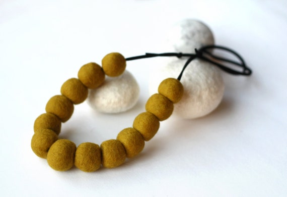 Felted bead necklace on suede - mustard yellow