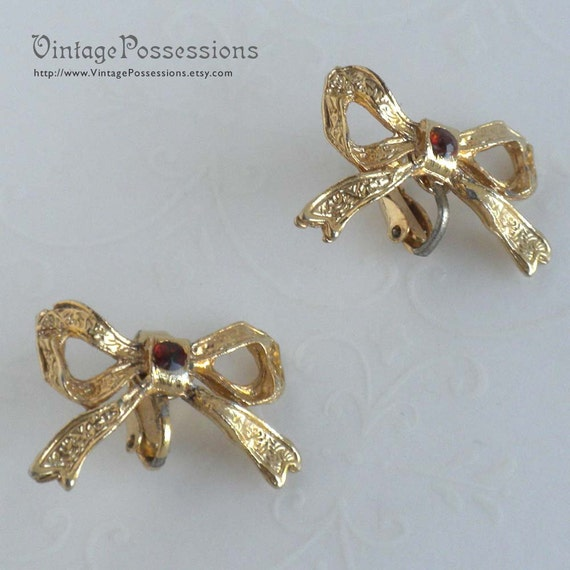 Textured Gold Tone Bow and Rhinestone Clip On Earrings