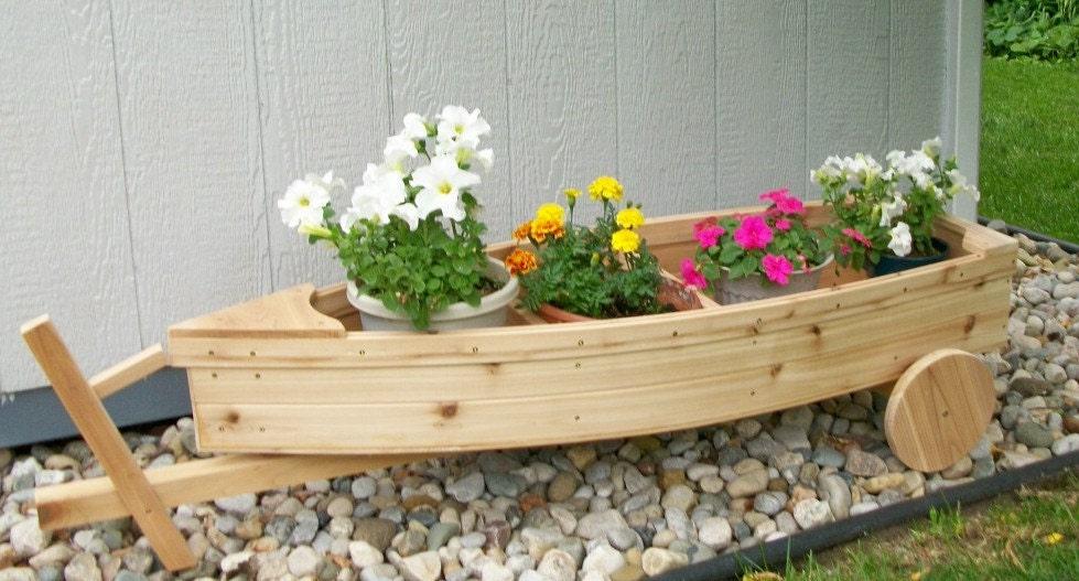 Nautical all cedar boat and trailer outdoor landscape garden