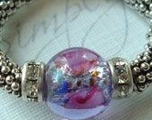 Easy On beaded ring .. Sterling Silver stretch ring in violet floral lampwork