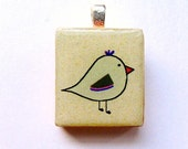 Bird pendant in light sandy brown