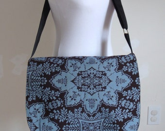 blue and brown messenger bag