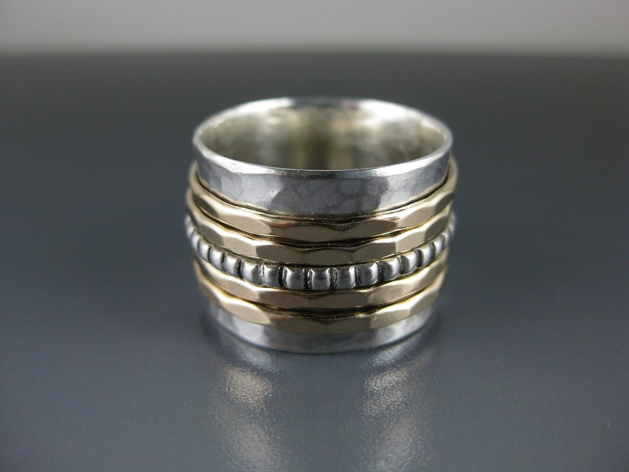 silver spinner ring with five spinners spinner ring