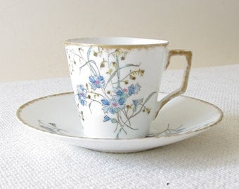 A Klingenberg Limoges Porcelain Demitasse Cup and Saucer