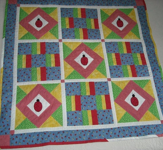 SALE Appliqued Lady Bug Quilt, Hand Quilted, child size 46 inch square
