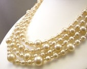 Beautiful vintage multi strand bridal necklace with cream glass faux pearls
